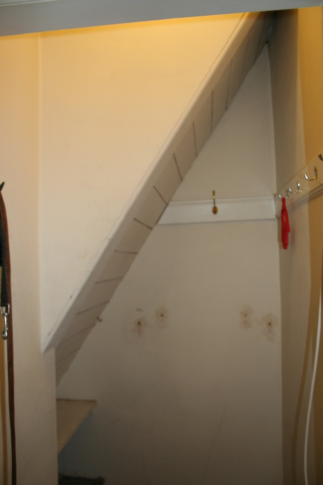 Coat cupboard before with underneath of stairs