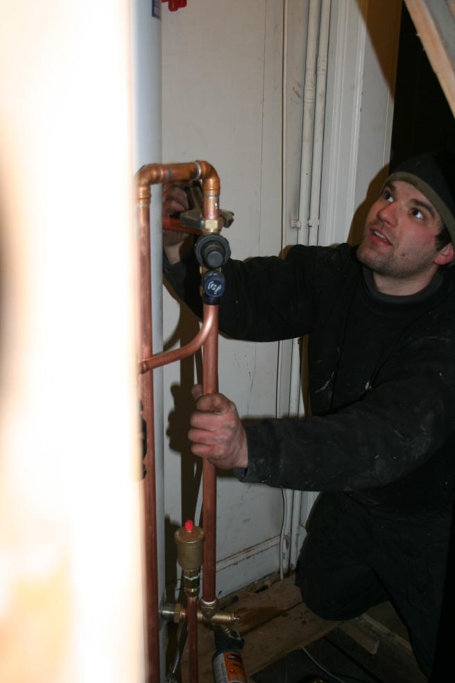 Mark installing the tank