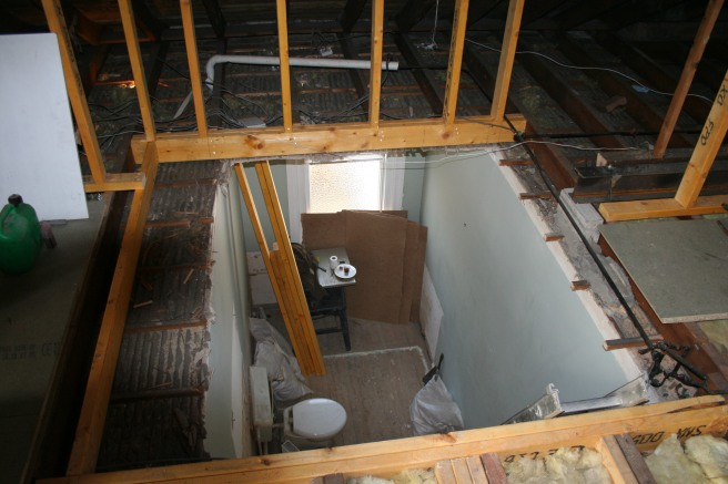 down to old bathroom, the space framed in timber is where the stair will go