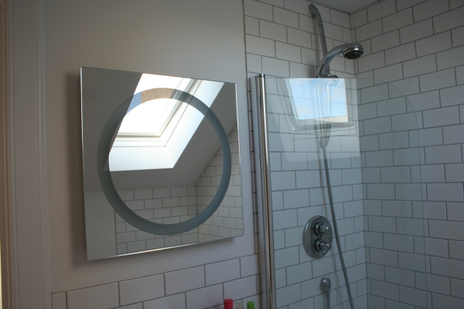 the mirror turns into a light when you wave your hand underneath it. clever. C's choice.