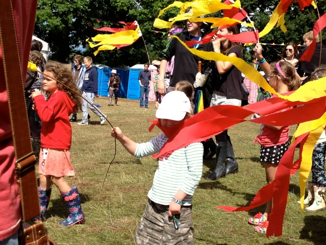 kids paraded round the fields on the Sunday with streamers on sticks, percussion that they had made and lots of cheering.  Brilliant team doing the kids' stuff