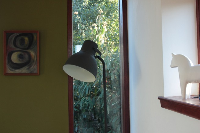 the far corner in the garden room with the sun streaming in